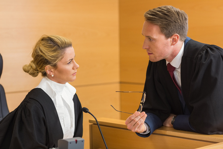 trial indoor: Lawyer speaking with the judge in the court room