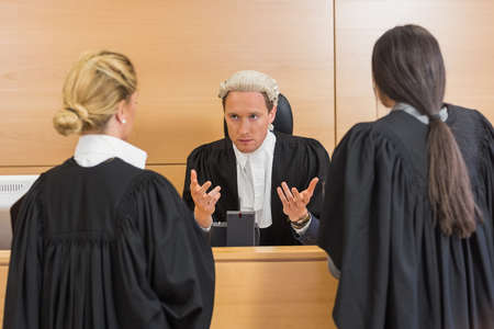 court room: Lawyers speaking with the judge in the court room