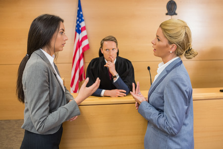 judges: Lawyers speaking with the judge in the court room