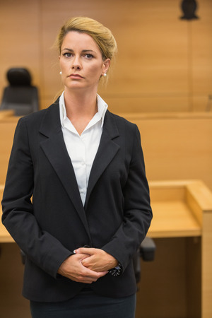 Serious lawyer looking at camera in the court room