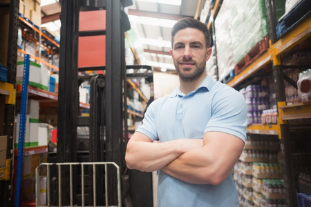 warehouse: Portrait of a confident worker smiling in the warehouse Stock Photo