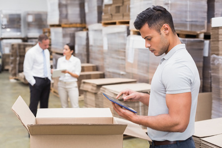 inventories: Portrait of male manager using digital tablet in warehouse