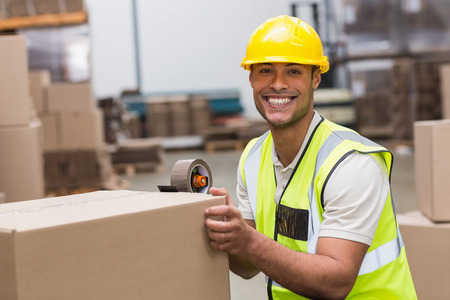 dispatch: Worker in warehouse preparing goods for dispatch