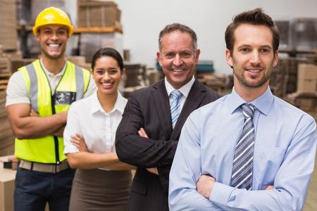 Warehouse team smiling at camera in warehouse photo