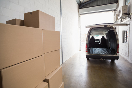 Empty van ready to be loaded in a large warehouse