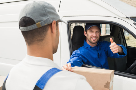 Delivery Driver Handing Parcel To Customer In His Van Outside ...