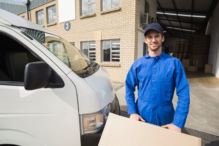 loading bay: Delivery driver packing his van in a large warehouse Stock Photo