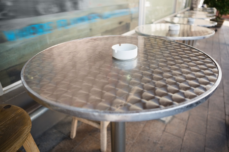 stool: Bar stool and table with ash tray at the bakery