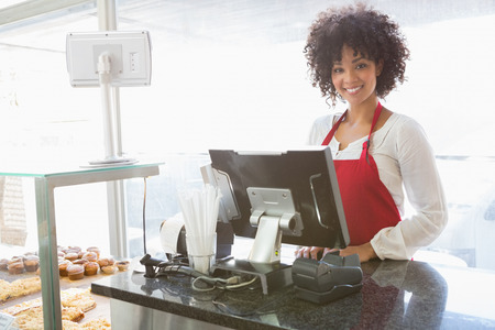 counter service: Beautiful waitress posing behind the counter at the bakery