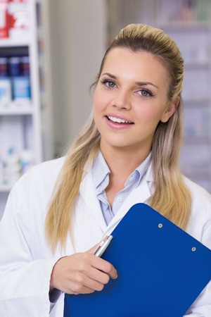 intern: Pharmacy intern smiling at camera at the hospital pharmacy Stock Photo
