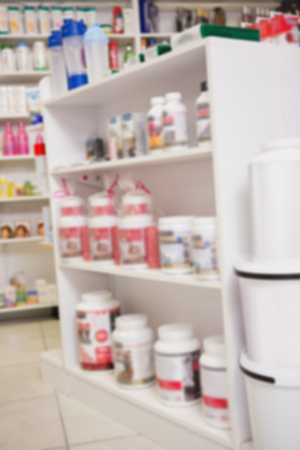 heal sickness: Close up of shelves of drugs in the pharmacy Stock Photo