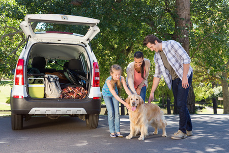 Family getting ready to go on road trip  on a sunny day