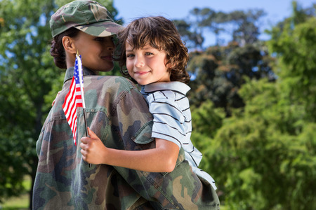Soldier reunited with her son on a sunny day Stock Photo - 36405597