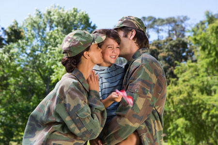 mom kiss son: Army parents reunited with their son on a sunny day