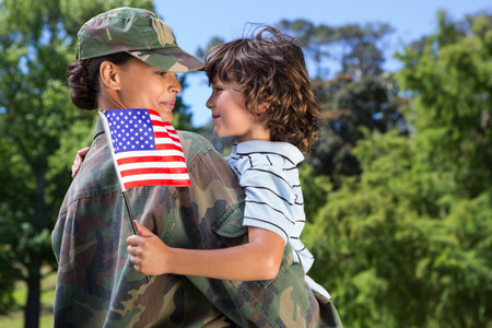 military uniform: Soldier reunited with her son on a sunny day