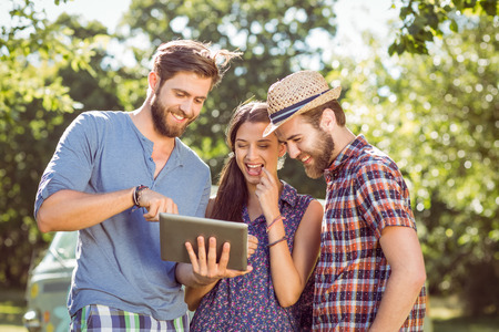 summers: Hipster friends looking at their selfie on a summers day