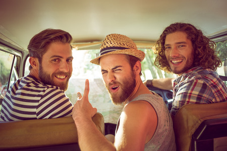 Hipster friends on road trip on a summers day 스톡 콘텐츠