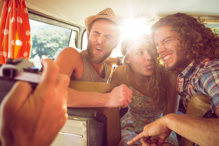 road: Hipster friends on road trip on a summers day Stock Photo