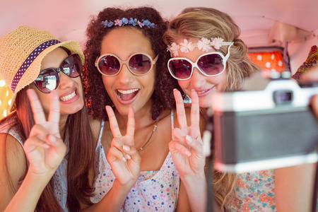 Hipster friends on road trip on a summers day photo