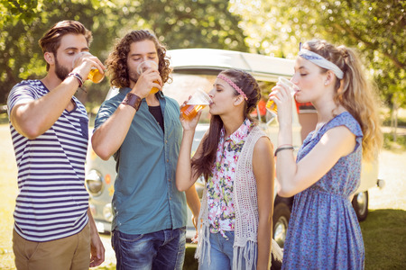 summers: Hipster friends having a beer together on a summers day