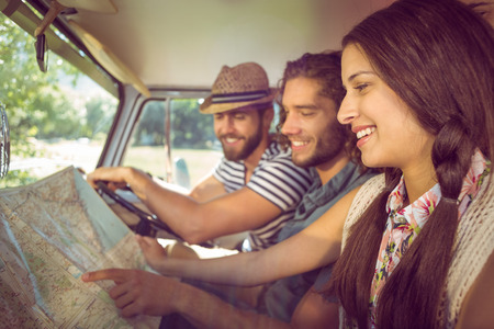 mini car: Hipster friends on road trip on a summers day Stock Photo