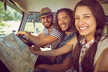 weather map: Hipster friends on road trip on a summers day Stock Photo