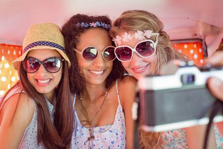 weekend activity: Hipster friends on road trip on a summers day Stock Photo