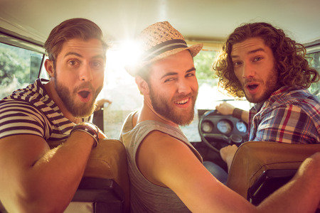 males: Hipster friends on road trip on a summers day Stock Photo