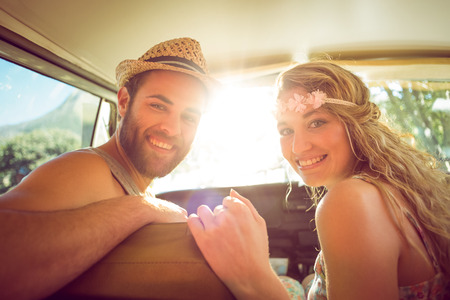 escapism: Hipster couple on road trip on a summers day Stock Photo