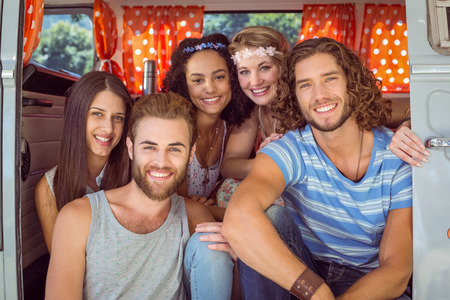 summers: Hipster friends in a camper van on a summers day