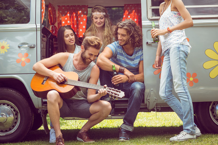 cars on the road: Hipster friends in camper van at festival on a summers day