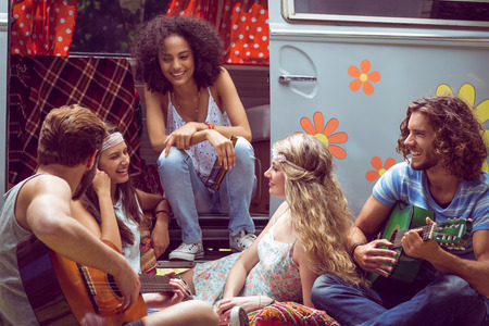 escapism: Hipster friends by camper van at festival on a summers day