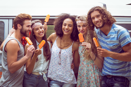 summer festival: Hipster friends enjoying ice lollies on a summers day