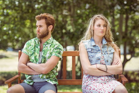 not talking: Young couple not talking after argument on a summers day