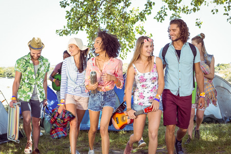 young adults: Young friends arriving at their campsite at a music festival
