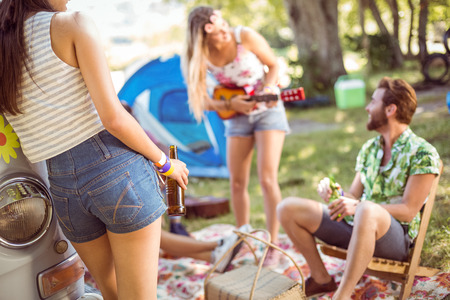 spring festival: Hipsters having fun in their campsite at a music festival