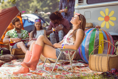 the carefree: Carefree hipster having fun on campsite at a music festival Stock Photo