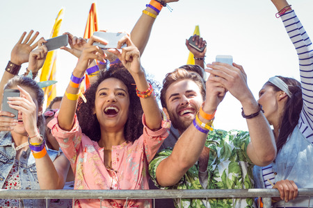 outdoor event: Excited music fans up the front at a music festival Stock Photo