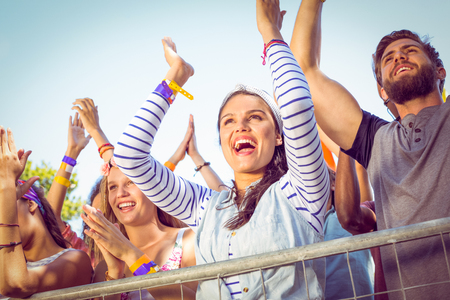 Excited music fans up the front at a music festival Archivio Fotografico