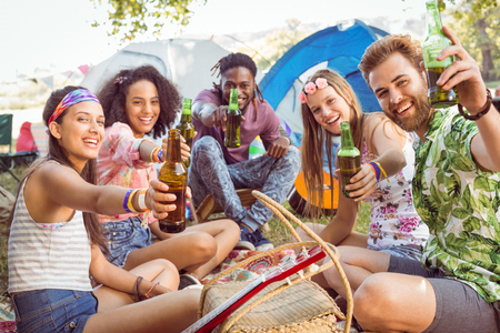 campsite: Hipsters having fun in their campsite at a music festival