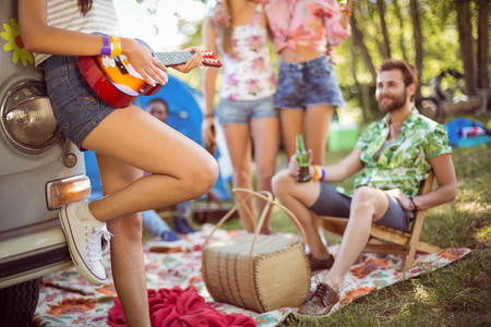 the festival: Hipsters having fun in their campsite at a music festival