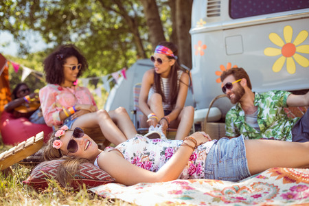 summer festival: Happy hipsters relaxing on the campsite at a music festival Stock Photo