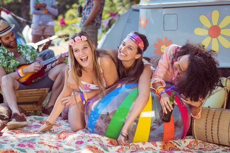 summer festival: Happy hipsters having fun on campsite at a music festival