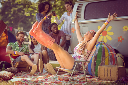 summer festival: Carefree hipster having fun on campsite at a music festival Stock Photo