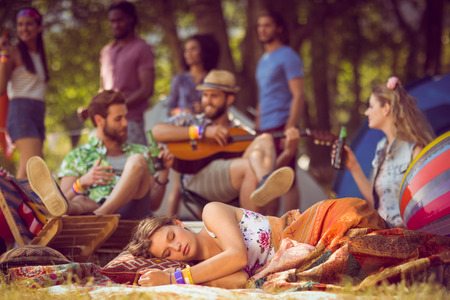 beer festival: Pretty hipster relaxing on campsite at a music festival