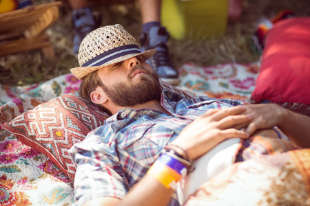 summer festival: Handsome hipster relaxing on campsite at a music festival