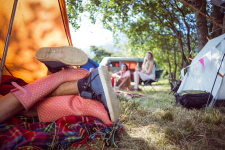 making love: Young couple making out in tent at a music festival Stock Photo