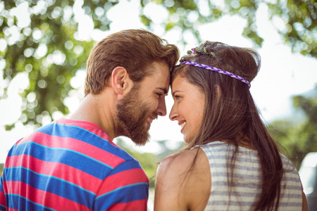 Hipster couple smiling at each other at a music festival photo
