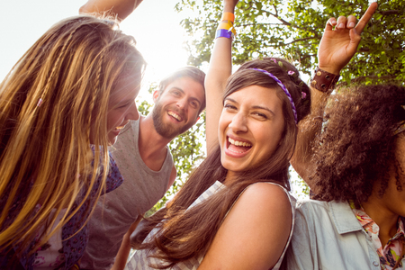 the festival: Happy hipsters dancing to the music at a music festival Stock Photo