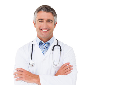 Happy doctor smiling at camera on white background